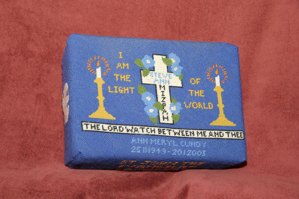 "63.  ""I am the Light of the world"" in memory of  Ann Meryl Cundy  (1949-2003) donated by her husband and worked by Beryl Johnson. The design is based on an Easter card with the theme of everlasting love. The scriptural text MIZPAH comes from Genesis 31.49"