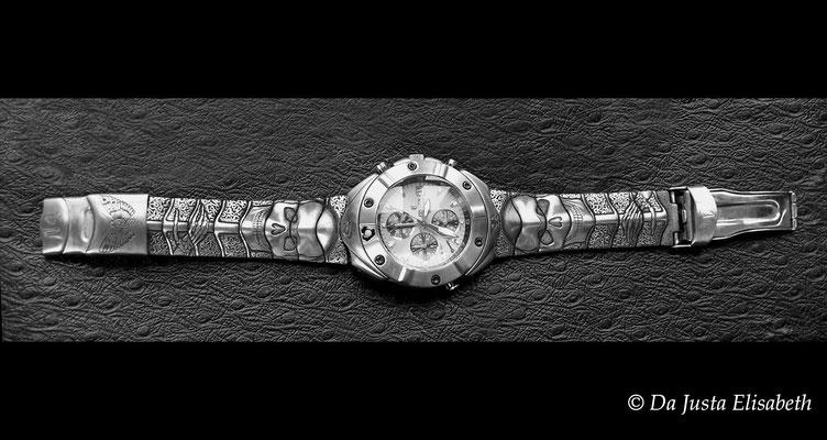 Gravure taille-douce sur montre