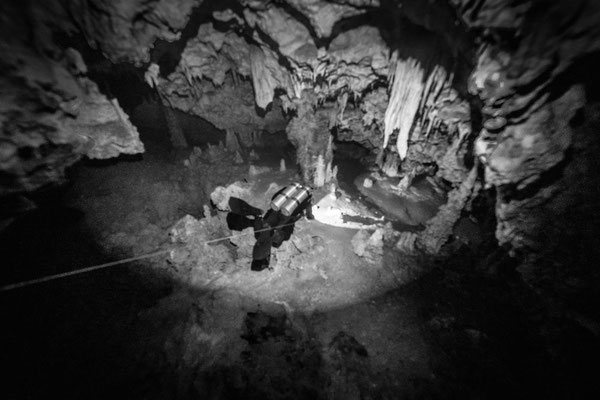 Underwater cave diving photo in black and white