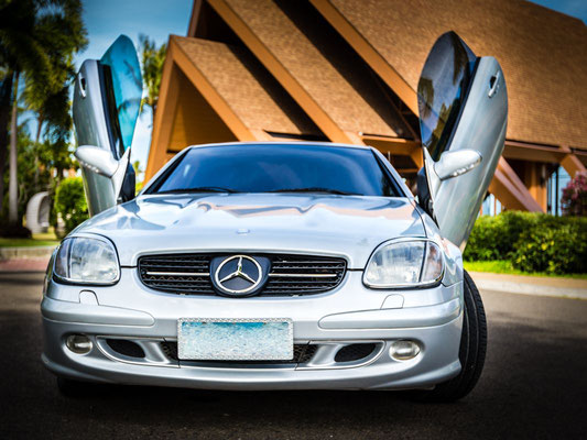 Photo of a Mercedes with lambo doors open