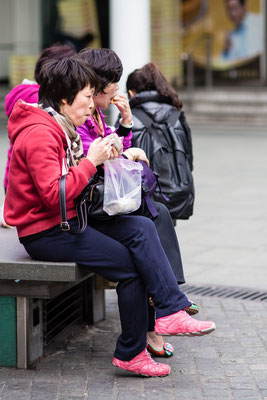 Photo of people eating in the street