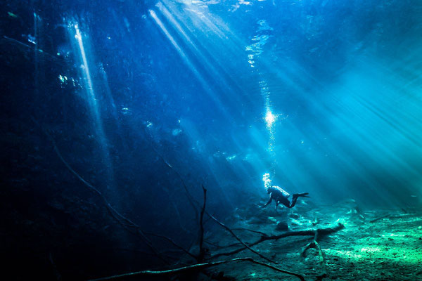 Photo with a light rays effect on a scuba diver