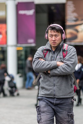 Photo of a man with pink headset