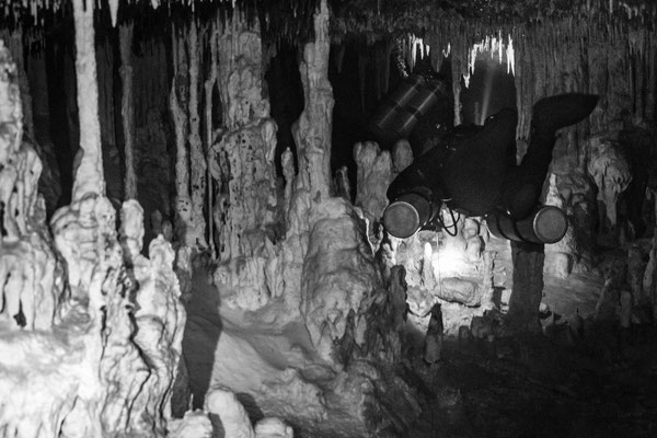 cave diving in black and white