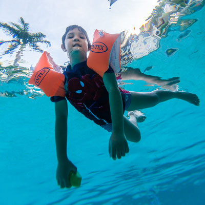 My son in a swimming pool from underwater