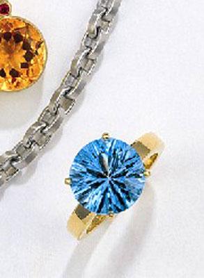 Ring - 750/- Gelbgold / Blauer Topas - - - - - - - -€  861,-