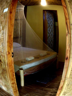 Ivory bungalow, bedroom, queen size bed, Nypa Style Resort, Camiguin