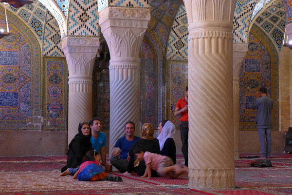 Women and men are relaxing together in the Molk Mosque in Shiraz.
