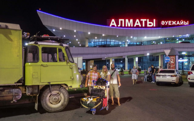 Arrive in Almaty after a long day...