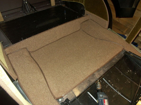 I have no idea how and where the original carpet was attached in the back.