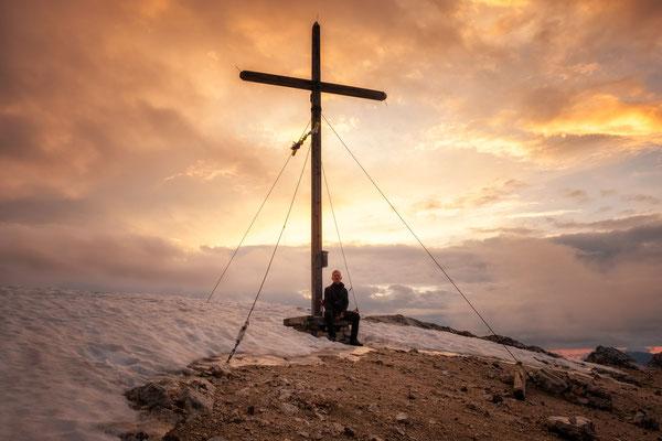 The summit cross on the Croda del Becco (Seekofel) at sunrise