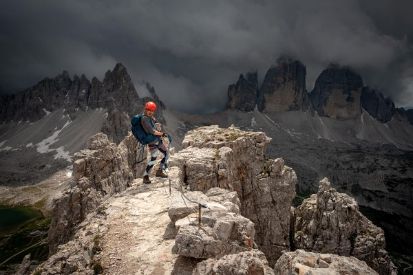 On the summit of Torre di Toblin with storm clouds approaching quickly