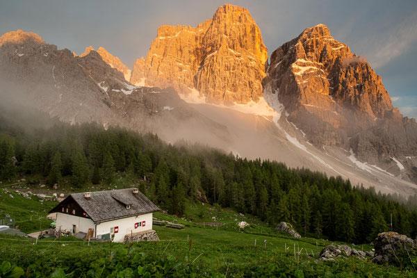 Rifugio Citta di Fiume with Mount Pelmo in the background.