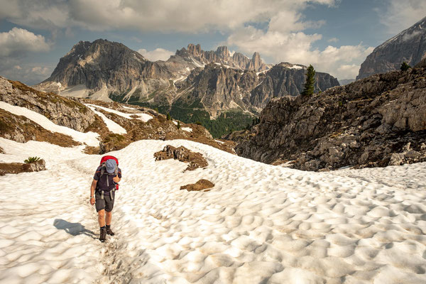 My dad hiking up to rifugio Averau with the dome shaped Mount Lagazuoi in the background