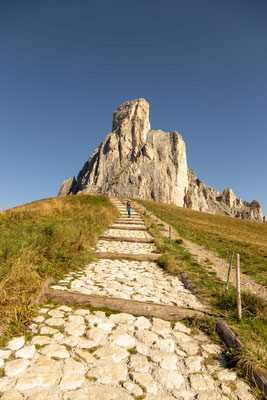 The stone steps on the descent to Passo Giau with Mount Ra Gusela in the background.