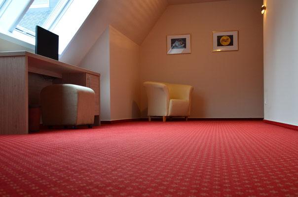 Teppichböden gibt es in vielfältigen Qualitäten und Designs - hier mal ganz klassisch