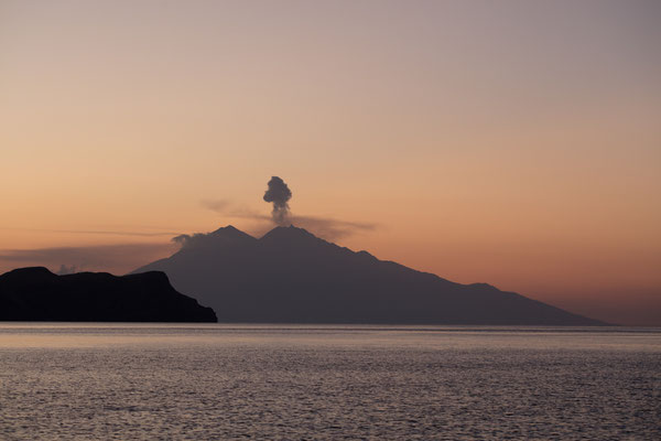 Sangeang Volcano blowing Ashes at Sunset