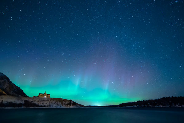 Northern lights in a starry night sky over the Prince of Wales Hotel in Waterton Lakes National Park © Denis Semenov @sdlphoto