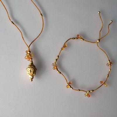 Buddhakopf 750er Gold, orangefarbige Saphire