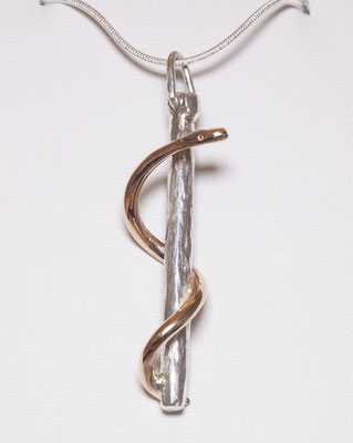 A pendant made for a medical graduation gift, sterling silver 'stick' with 9ct rose gold snake with its as a safe place to hold ring during surgery