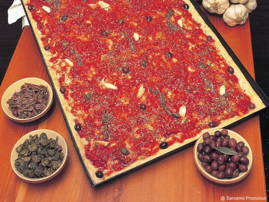 Sardenaira, a typical local kind of pizza, made with tomato, garlic, olives and anchovies