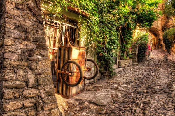 Bussana Vecchia - An artistic village, built on the ruins of an abandoned medieval village, stands out on a rolling hill behind Sanremo giving a suggestive and unrealistic image of itself ...