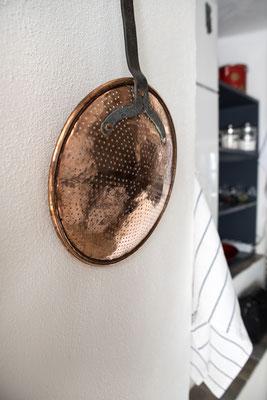 Kitchenette - Detail of ancient copper colander