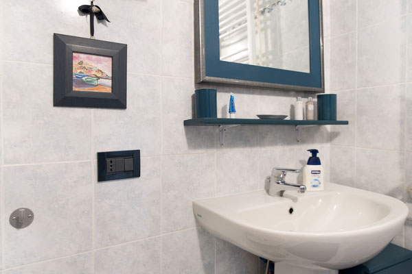 Bathroom - Sink, mirror and various products offered to the guests