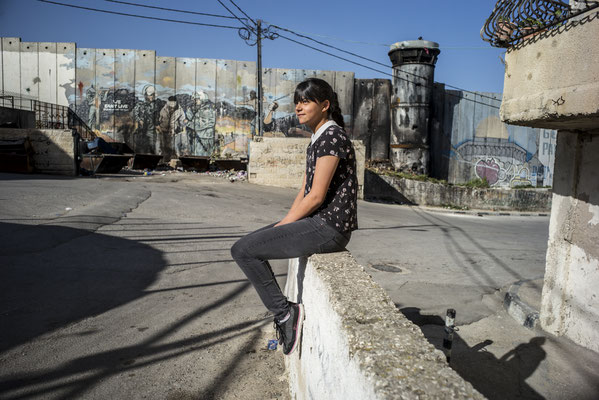 Rowaida, 16 years old, just beside the separation wall - The Youngsters of Aida Camp, Bethlehem, Palestine © François Struzik - simply human 2018