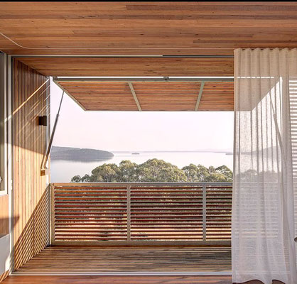 Love this picture of a room & wooden balcony