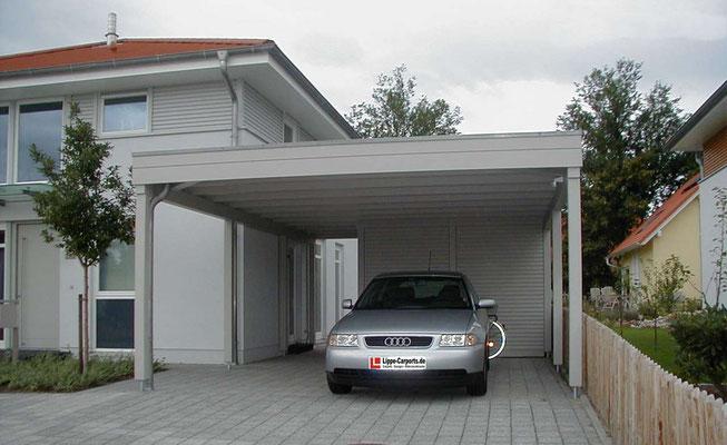 Beispiel-Nr. MGR-3.3   Die Wandverkleidungen dieses Doppelcarports MÜNCHEN-GR wurden der Hausfassade angepasst.
