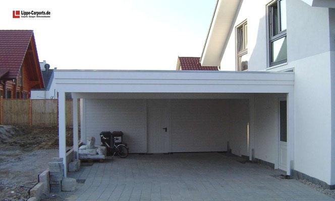 Beispiel-Nr. MGR-8    Doppelcarport MÜNCHEN-GR genau zwischen Grenze und Wohnhaus eingepasst. Abmessungen hier 6,20m x9m incl. Gerätekammer.