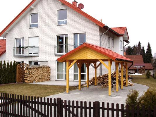 Beispiel-Nr. MST 2    MÜNSTER-Giebeldachcarport an einem Wohnhaus in Bielefeld.