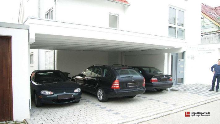 Beispiel Nr. SORC27   Dreiercarport Anlage an einem Neubau in Leonberg. Dieses Carport wurde nur auf 4 Pfosten errichtet.
