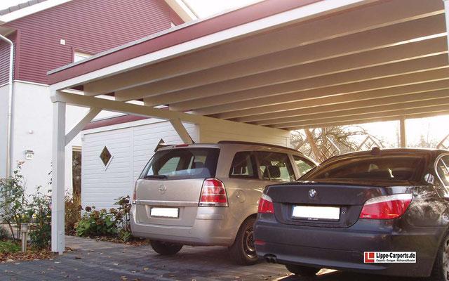 Beispiel-Nr. MGR-24.2   Freitragendes 6m breites MÜNCHEN-GR Doppel-Carport farblich an die Wohnhaus-Fassade angepasst.