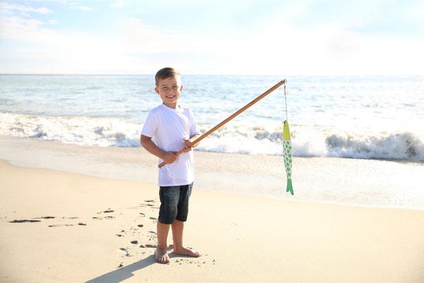 Boy photo shot in ocean.  Boy  photo session. Florida. Port St. Lucie.  Photographer PA, NJ, NY, FL Malgorzata Tudruj 215-837-6651 www.momentsinlifephoto.com