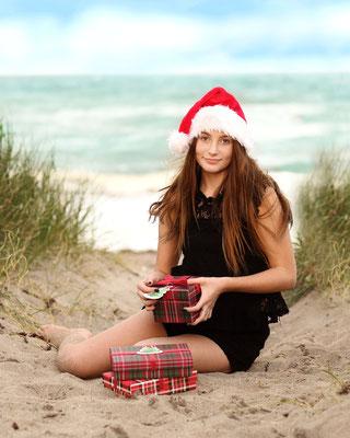 Girl. Ocean. Christmas time. Ocean.  Beach photo session. Photographer Port. St. Lucie. Florida. Malgorzata Tudruj 215-837-6651 www.momentsinlifephoto.com Specializin portrait, event, wedding.