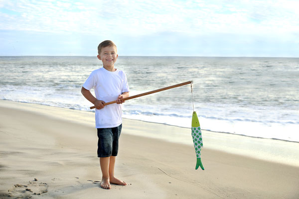 Boy. Beach photo sessions. Pcean.Vacation, summer photo session.  If you are interested, please message me. Photographer Port St. Lucie Floryda. Gosia & Steve Tudruj 215-837-6651 www.momentsinlifephoto.com