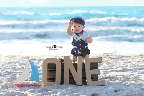 Birthday photo session in the beach. Kids photo shot.  Baby boy pictures in ocean.  Photographer Port St. Lucie Florida.  Malgorzata & Steve Tudruj  215-837-6651   Photography servise Fl, NJ, PA, NY www.momentsinlifephoto.com