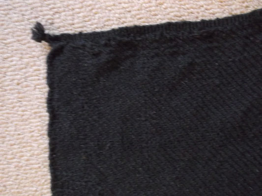 Webkante und Ecke des Manteltuchs