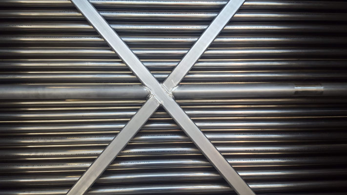 Bare-Tube Heat Recuperator Tubes (picture showing a Anytherm unit with over 1'500 stainless steel tubes)