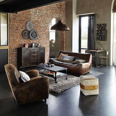 Esprit loft New York : canapé et fauteuil club cuir, briques et style épuré