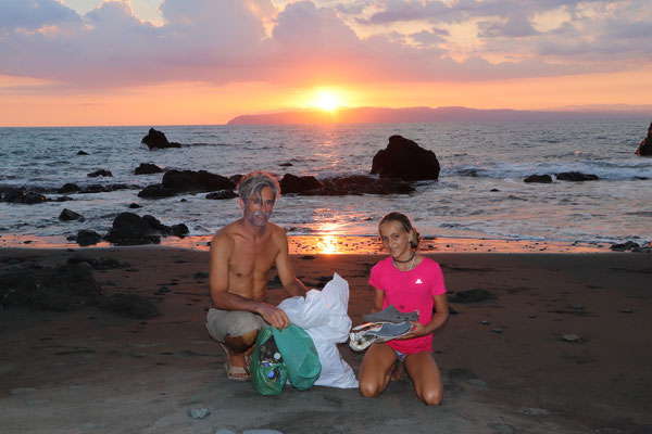 After an evening walk down the beach we pose with our bags of rubbish collected on the way