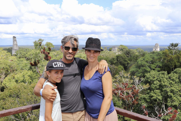 On top of the astronomical Pyramid overlooking the centre of Tikal where you see the stair temples rise out of the jungle
