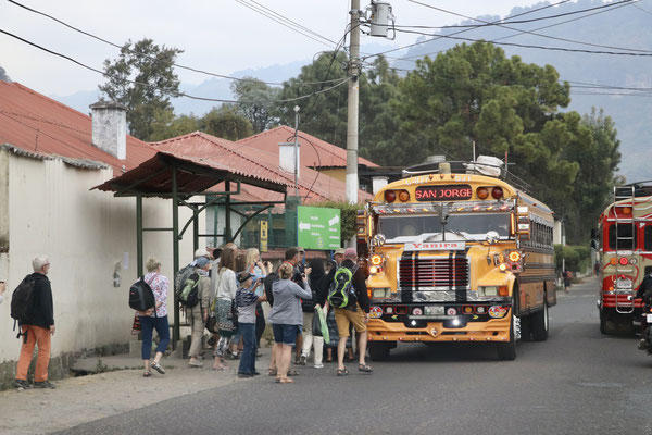 At last after a 11.5h drive through winding mountain roads we arrive in Panajachel at the Lake of Atitlan - Here a typical souped up US school bus