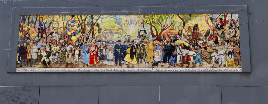 A famous painting made by Diego di Riviera on a wall in the middle of Mexico City