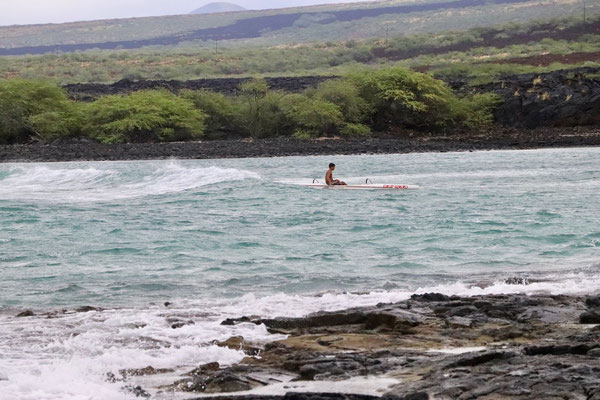 Hawai'ian Canoe surfing the waves