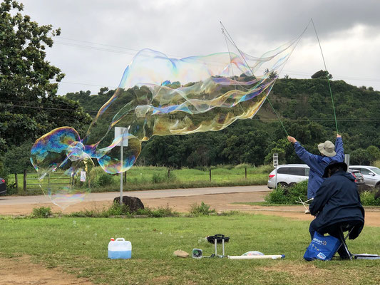 A women made huge soap bubbles of the sea breeze