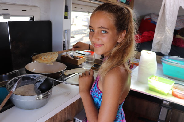 Lynn prepares pan cakes for breakfast...