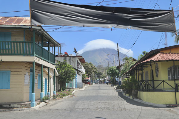 Off the ferry and into to the streets of Moyogalpa with the cloud covered Volcan Concepcion in the distance